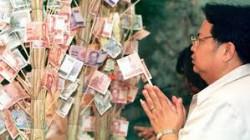 Foto: Bidden en geld